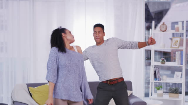 dancing away all my worries - young couple stock videos & royalty-free footage