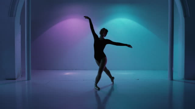 dancing ballerina in a colorful studio - dance studio stock videos & royalty-free footage