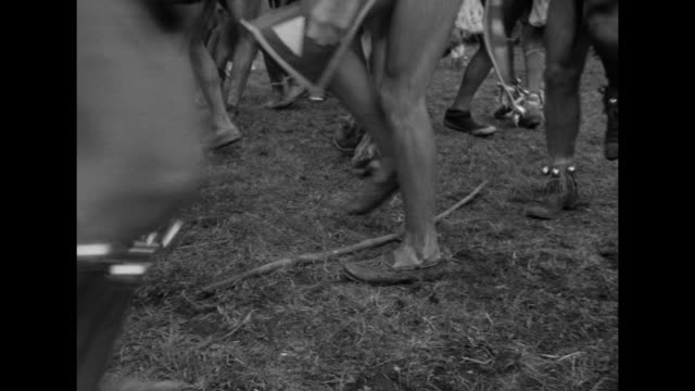 vs dancing boys in feathered headdresses loincloths and moccasins perform at the world scout jamboree - ネイティブアメリカン点の映像素材/bロール