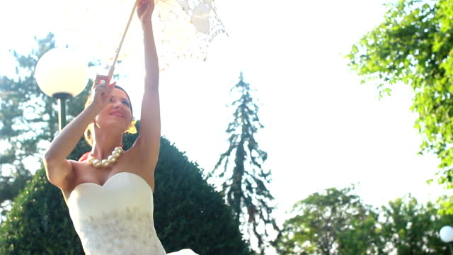 dancing bride with parasol - parasol stock videos & royalty-free footage