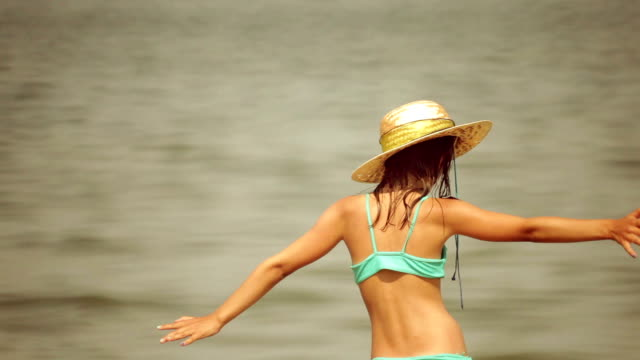 dancing by the sea - straw hat stock videos & royalty-free footage