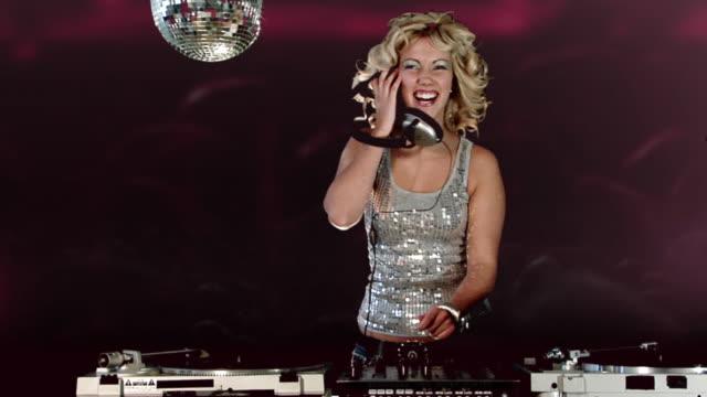dancing dj girl - dj stock videos & royalty-free footage