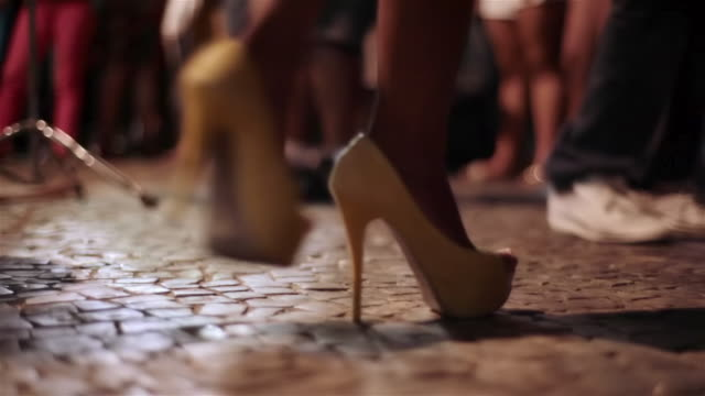 dancing feet step and spin to brazilian samba music - high heels stock videos & royalty-free footage