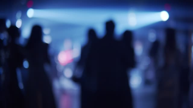 dancing girl in a night club (defocus) - blurred motion stock videos & royalty-free footage