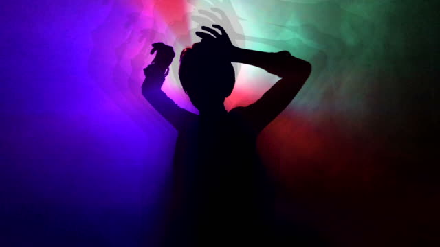dancing girl in a night club - colori video stock e b–roll