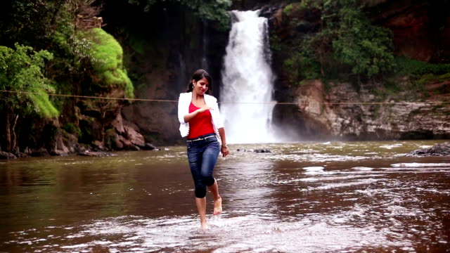 dancing girl near the harvalem waterfall - one teenage girl only stock videos & royalty-free footage