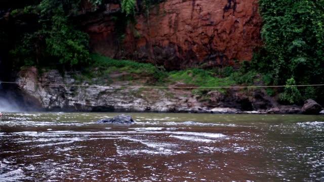 stockvideo's en b-roll-footage met dansende meisje in de buurt van de waterval van harvalem - alleen één tienermeisje