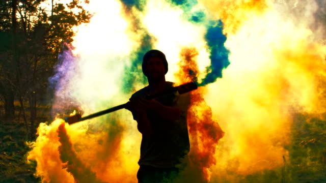dancing in colored smoke - colori video stock e b–roll