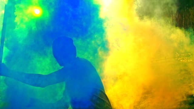dancing in colored smoke - yellow stock videos & royalty-free footage