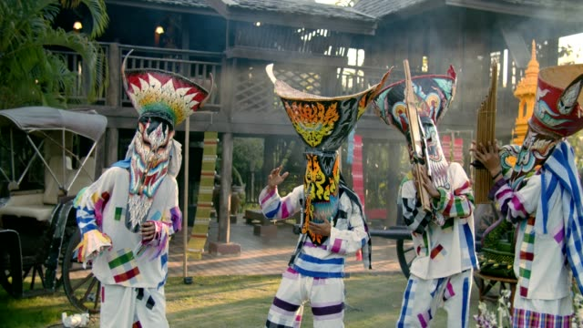 4k : dancing in phi ta khon festival - traditional clothing stock videos & royalty-free footage