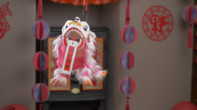 dancing lion against chinese new year background - big cat stock videos & royalty-free footage