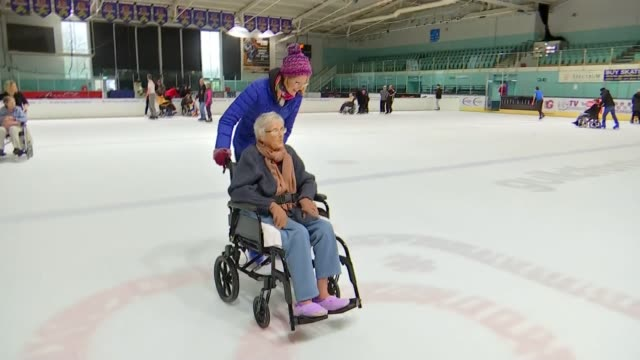 'dancing on ice' series inspires new generation of ice dancers uk carers and people in wheelchairs along on ice rink reporter ice skating with... - ice skating stock videos & royalty-free footage
