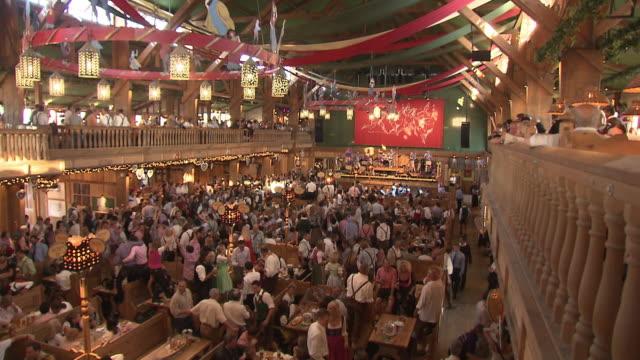 dancing people in  beer tent - german culture stock videos & royalty-free footage