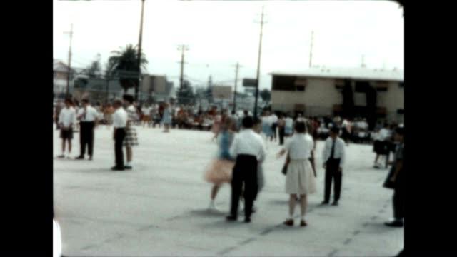 vídeos de stock e filmes b-roll de dancing performance at the fair avenue elementary school in the san fernando valley in the 1960's. - dança quadrada