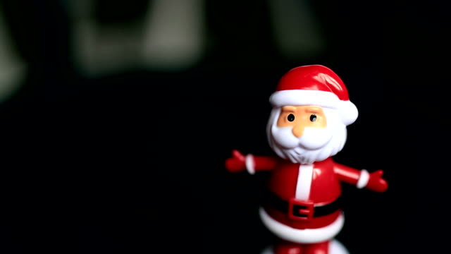 Dancing santaclause, black background, funny, happy