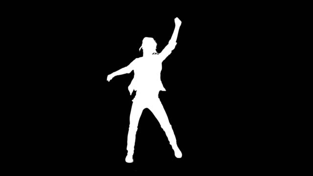 dancing silhouette. woman on black background. alpha - controluce video stock e b–roll
