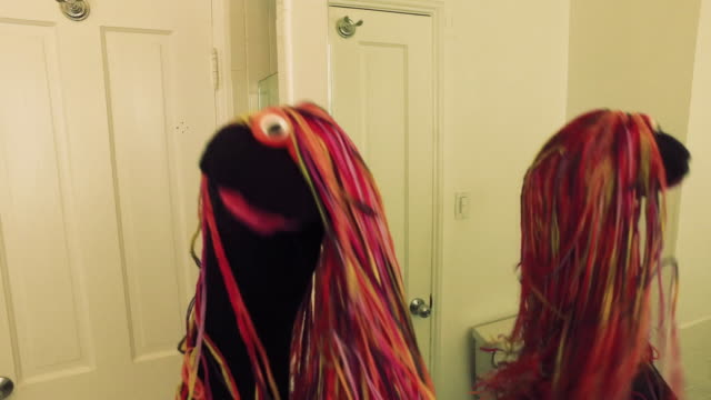 dancing sock puppet with long colorful hair - socke stock-videos und b-roll-filmmaterial