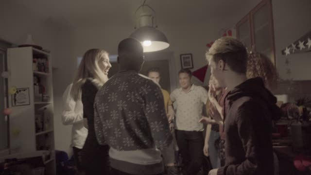 dancing teenagers seen through tinsel curtain - tinsel stock videos & royalty-free footage