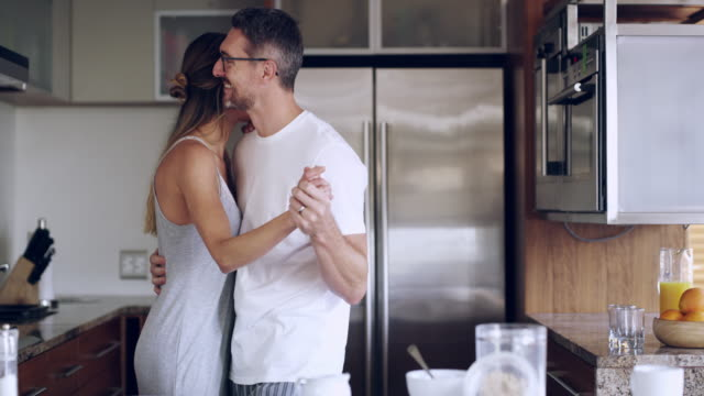 dancing to a day of bliss together - kitchen stock videos & royalty-free footage
