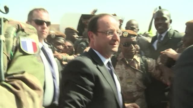 dancing to the beat of drums forbidden by their islamist occupiers timbuktu residents gave president francois hollande a reverent welcome saturday... - françois hollande stock videos & royalty-free footage