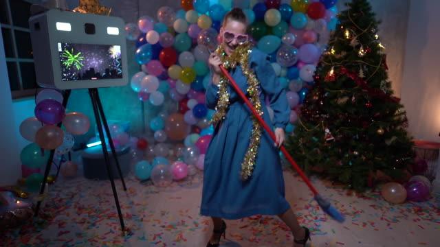 dancing woman with broom on high heels having fun - tinsel stock videos & royalty-free footage