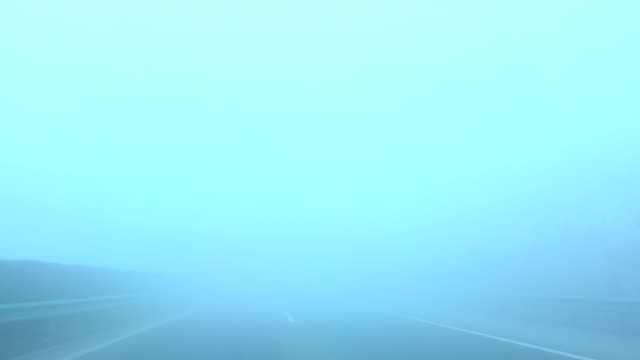 danger driving in thick fog day - thick stock videos & royalty-free footage