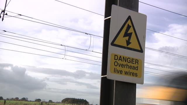danger overhead wires - warning sign stock videos & royalty-free footage