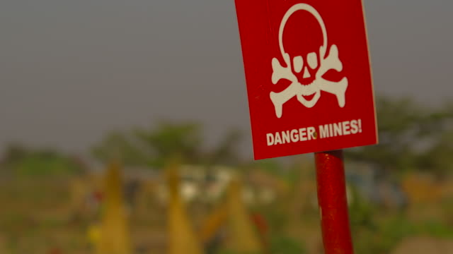 danger sign, rack focus to angolan villagers - rack focus stock videos & royalty-free footage