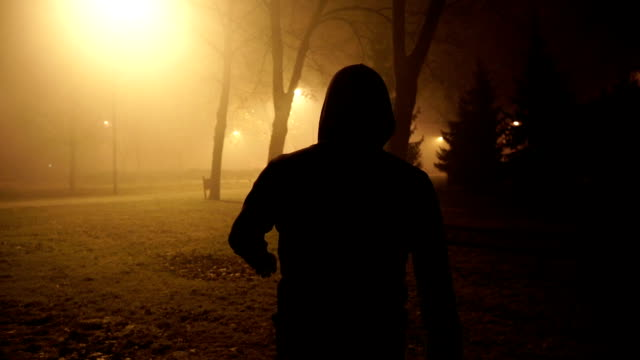 danger violence man walking at misty night - urban road stock videos & royalty-free footage