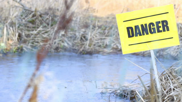 danger warning sign near the water - water pollution stock videos & royalty-free footage