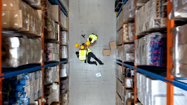 dangerous accident during work. first aid. drone point of view - warehouse stock videos & royalty-free footage