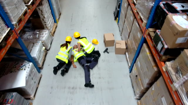 dangerous accident during work. first aid. drone point of view - package stock videos and b-roll footage
