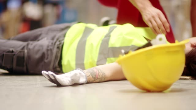 dangerous accident during work. first aid - injured stock videos & royalty-free footage