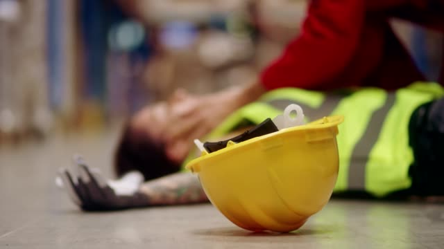 dangerous accident during work. first aid - place of work stock videos & royalty-free footage