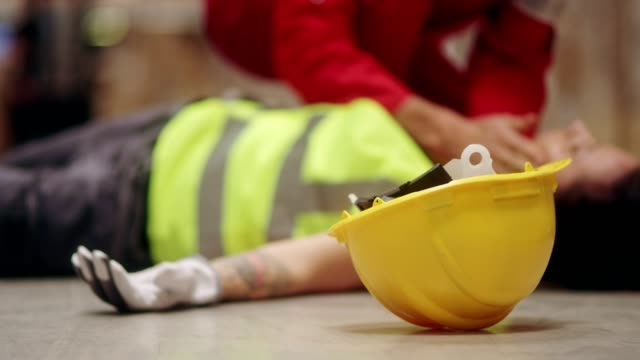 dangerous accident during work. first aid - first aid stock videos & royalty-free footage