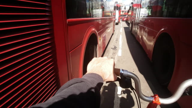dangerous bicycle ride in london whitehall - double decker bus stock videos & royalty-free footage