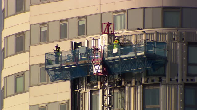 dangerous flammable cladding removed from block of flats in salford - fire natural phenomenon stock videos & royalty-free footage
