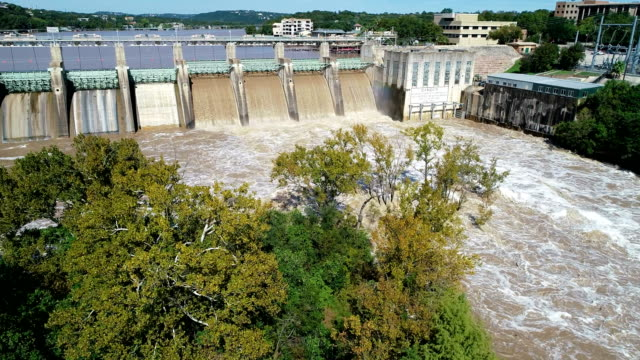 dangerous flood water released behind hyrdoelecctric dam - hydroelectric power stock videos & royalty-free footage
