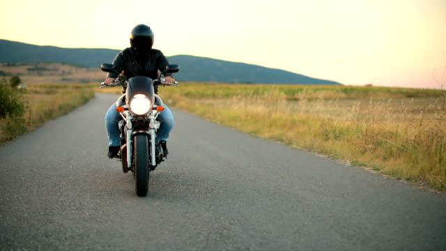 dangerous man on motorcycle - helmet motorcycle stock videos and b-roll footage