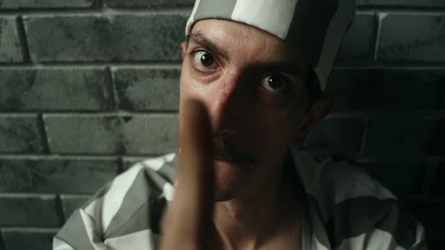 Dangerous men threatening at prison cell