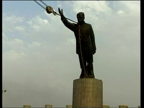 dangerous new enemies: threat to peace; lib iraq: baghdad: ext statue of saddam hussein being toppled - statue stock videos & royalty-free footage