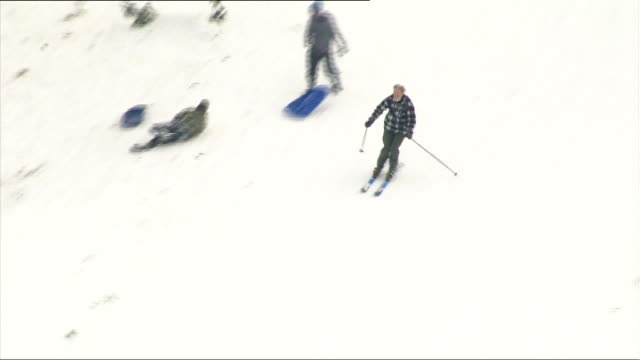 box hill ext man skiing down slope - surrey england stock videos & royalty-free footage