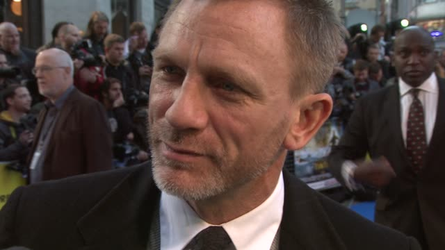 Daniel Craig on filming in just one room on Peter Jackson directing via satellite on playing a baddie at the The Adventures of Tintin UK Premiere at...