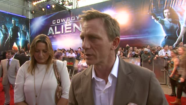 daniel craig on first reading the scrip it not being a comedy working with real cowboys and more at the cowboys aliens uk premiere at london england - cowboys & aliens stock videos and b-roll footage