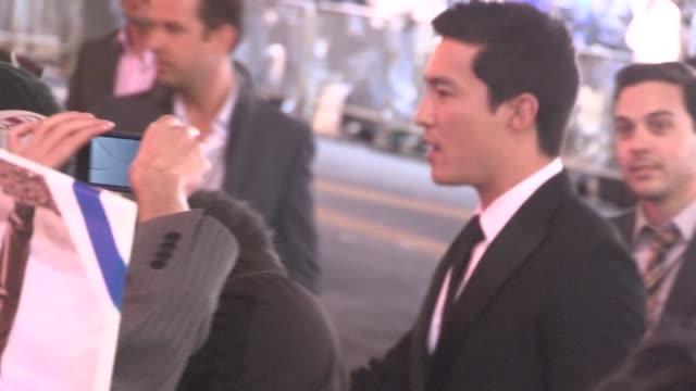 vídeos y material grabado en eventos de stock de daniel henney greets fans at the last stand premiere in hollywood 01/14/13 - el último desafío