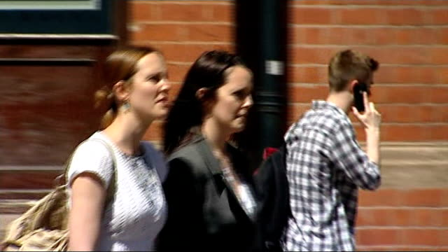 mother and stepfather found guilty birmingham crown court ext lisa godfrey along from court with another - 継父点の映像素材/bロール