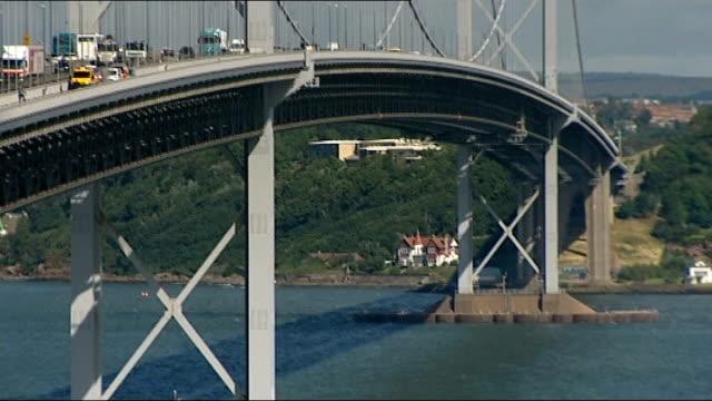 vidéos et rushes de general views of forth road bridge and family home / children 1st interview scotland fife ext traffic along forth road bridge - suicide