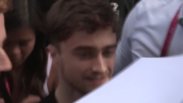 daniel radcliffe greets fans while entering the 2014 comic con panel in san diego in celebrity sightings in san diego - san diego comic con stock videos and b-roll footage