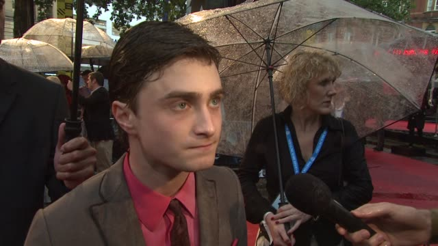 daniel radcliffe on why it always rains at harry potter premieres on playing a more grownup character now and how that is different at the harry... - harry potter stock videos & royalty-free footage
