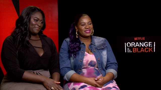 interview danielle brooks adrienne c moore on their characters fans getting cast being part of pop culture at the orange is the new black junket on... - cast member stock videos & royalty-free footage